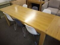 Solid oak dining table and 6 chairs,