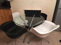 Glass modern dining table with 4 Eames Style chairs
