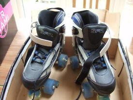 SFR Typhoon Roller boots: Size 3-6 (adjustable). Excellent condition.