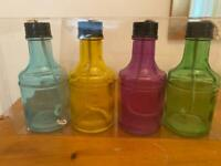 4 pretty glass bottles for paraffin lighting. Ideal for patios