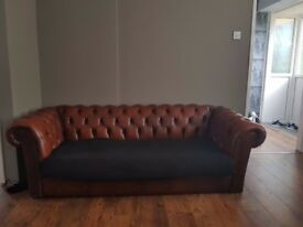 Brown chesterfield 2 x 3 seater sofas