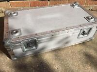 Silver grey flight case.