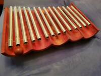 Metal pipe xylophone with wooden base