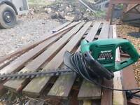 Electric chain saw and hedge trimmer