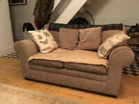 Lovely two seat sofa. Like new condition. From a smoke & pet fre home.