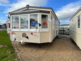 Cheap static caravan for sale sited in Essex by the sea