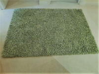 TWO DUNELM GREEN RUGS REDUCED