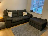 3 seater black sofa with matching footrest
