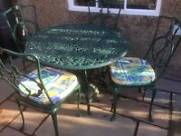 Garden Table, (Dark Green Metal) Parasol Base, Four Chairs, Seat Pads. £150 (cash) V.Good Condition