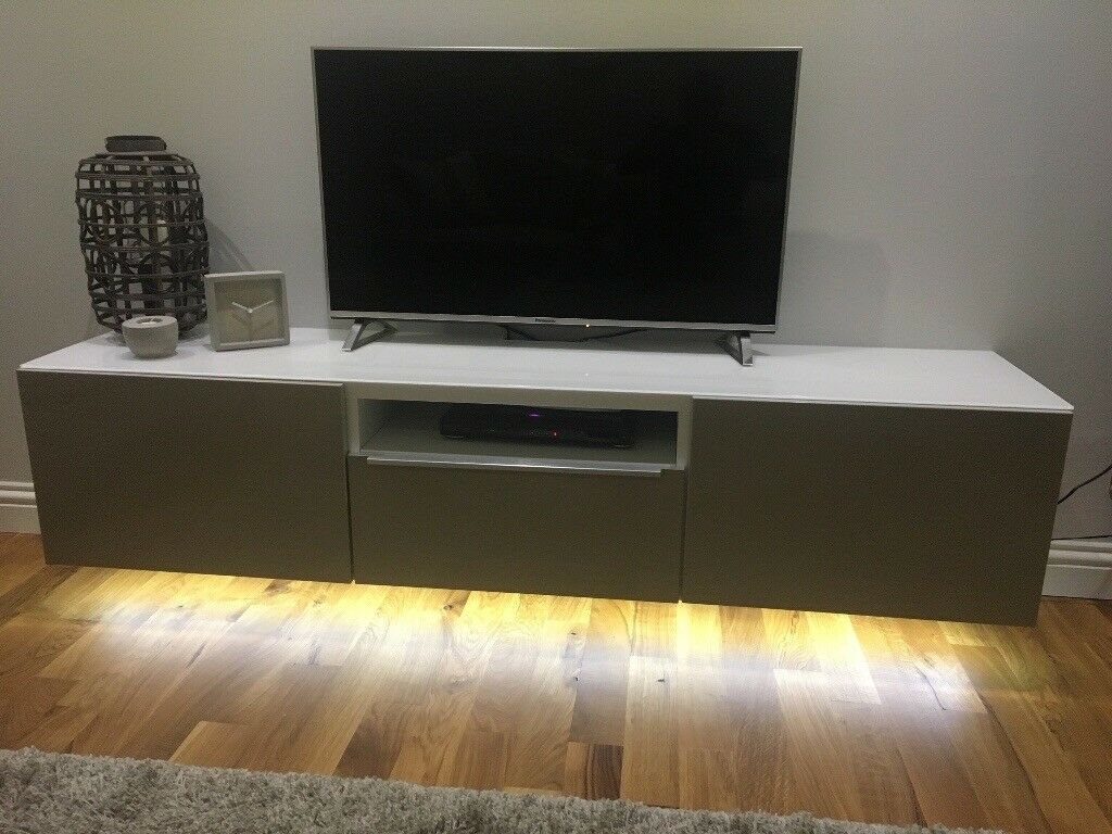 best service 4a742 42718 Wall hung IKEA BESTA white tv unit with beige doors, glass top, led tape  light fitted underneath | in Tullibody, Clackmannanshire | Gumtree