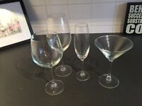Mix of glassware - red wine, white wine, champagne, martini