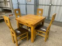 Solid oak extending dining table & leather chairs * free furniture delivery *