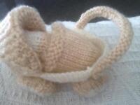 Hand knitted pram and baby