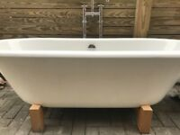 Freestanding acrylic bath with taps
