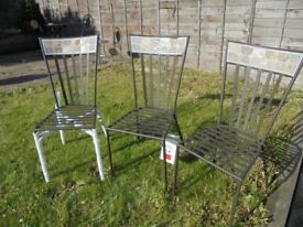 3 garden chairs with mosaic detail on back solid metal and heavy not aluminium rubbish