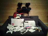 Wii family bundle, fit board, drums,guitar,23 games,motion handsets,lots of accessories + chargers