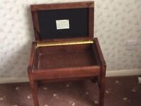 Wooden, brown upholstered piano stool with storage