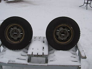 PAIR of 225/70R15 Winterforce Snow Tires on Jeep Wheels