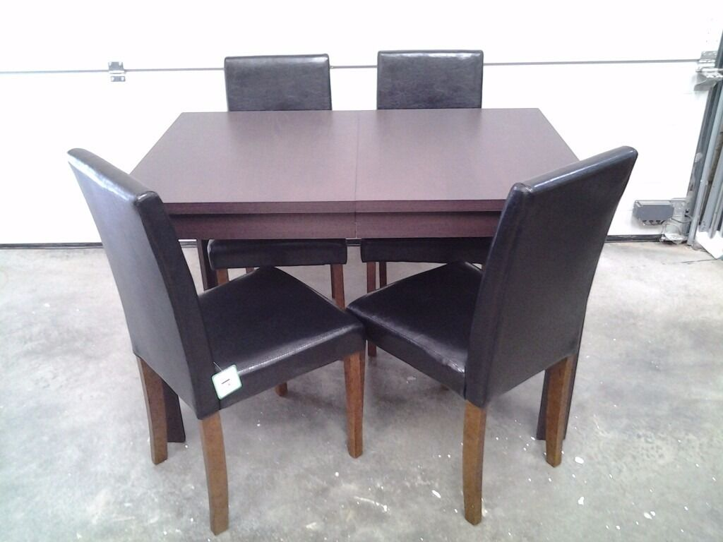 New extendable table and 4 unused excellent chairs. Bargain, can deliver.
