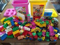 Assorted Lego Duplo blocks in storage boxes