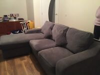 Grey 3 seater settee with footstool.