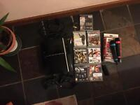 PS3 console with two controllers and games bundle