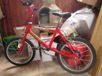 Kid's Raleigh Bike With Stabilizers.