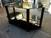 GLASS TOP TV TABLE