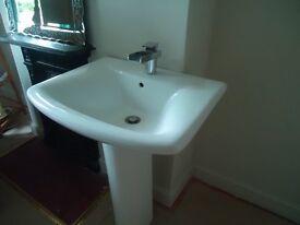 Modern bathroom basin and waterfall tap