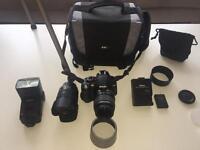 Nikon 3100 camera, lenses, flash, tripod, spare battery