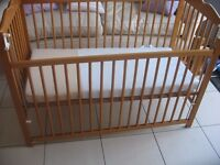 Dropside cot with mattress