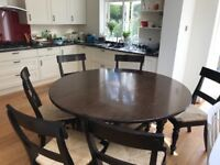 For sale: Solid wood 6-seater drop leaf table with 6 chairs