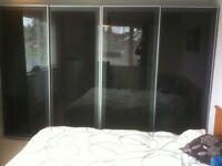 2 Double Black Glass Sliding front Wardrobes