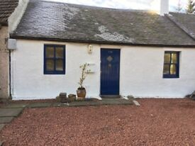 Traditional stone cottage in rural Scotland