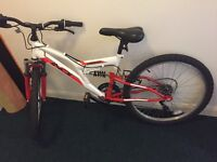 Indi unleashed mountain bike in red and white 24""