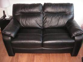 2 Black leather 2 seater sofas plus 1 black leather footstool for sale
