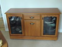 Teak low level glass front sideboard.
