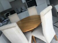 Oak round dining table with 4 chairs.