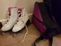 White Teku Ice Skates and bag in excellent condition.