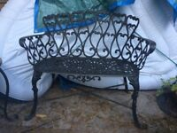 2 seat wrought iron patio chair.