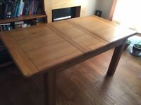 Harveys Solid Oak Extending Dining table. Outstanding condition (Like new)