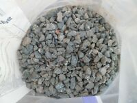 4 half bags &some loose Blue Garden Gravel.(bring some bags)FREE.