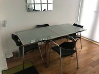 "Extendable glass/chrome dining table + 4 ""splash"" designer chairs"