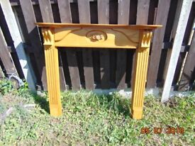 wooden fire suround in good condition some warping to the bottom ends