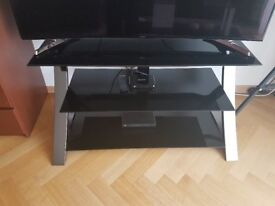 Extremely stylish like NEW black TV stand tempered glass. Fits a 55'' TV