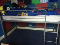 Metal cabin bed.