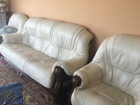 Set of four cream leather sofas: 3 single chairs, and one large three-seater