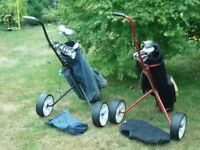 Full set of mens clubs and half set of ladies clubs with bags and trollies