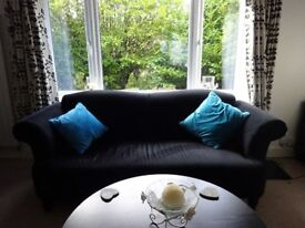 Three seater fabric sofa with two wing chairs