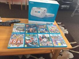 Wii U with 8 games